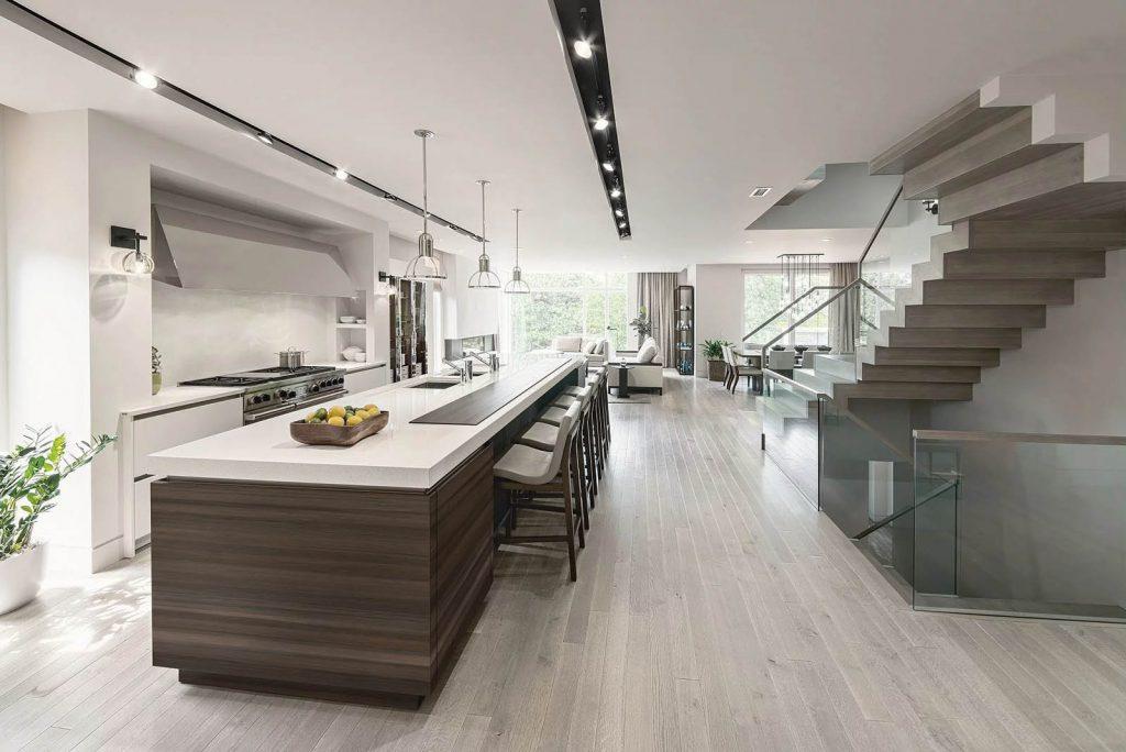 SieMatic classic keuken met een houtkleurige eiland ombouw en een wit werkblad. Het keukeneiland heeft bijpassende krukken.