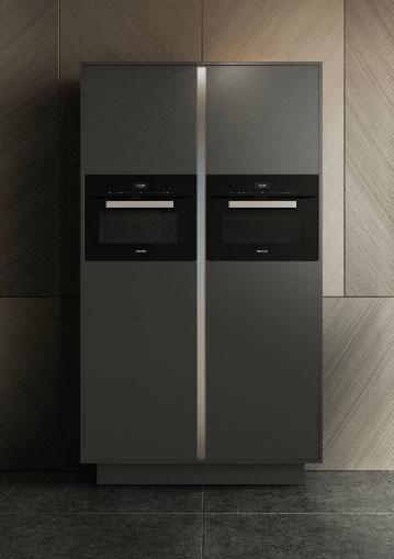 SieMatic Pure grafietgrijze keukenkast met twee ingebouwde ovens.