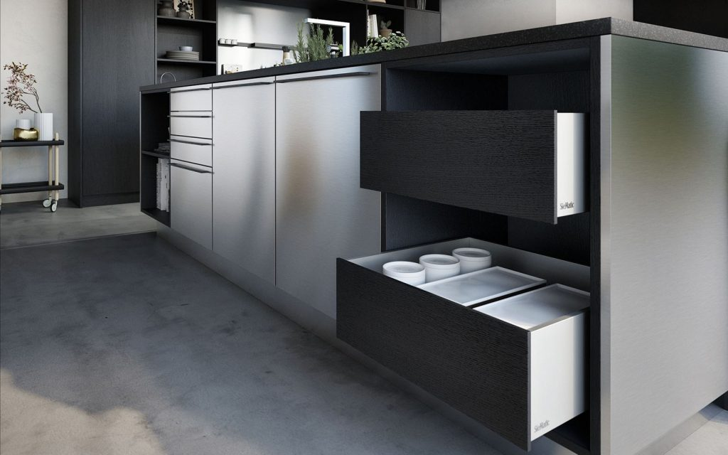 Een SieMatic Urban hoekkeuken met een glanzend grijze afwerking. In de lades word er gebruik gemaakt van het SieMatic Aluminium interieursysteem.